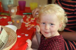 Child decorating plant pot