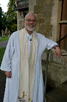 The Revd Bruce Nicole at the door of the church