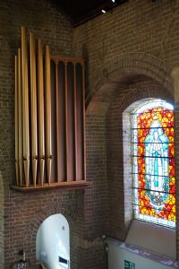 restored organ pipes and speaker box.