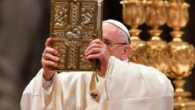 Word of God Jan 2020 Image of Pope Francis holding book of Scriptures up.