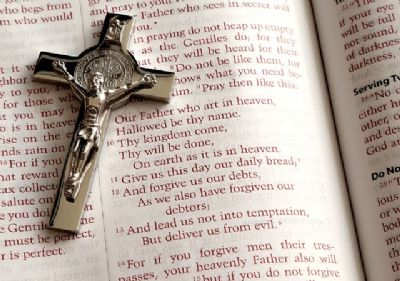 Bible woth cross rosary lying on bible open pages