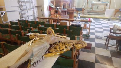 Crucifix and altar prepared for cleaning & repainting