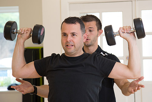 Dan sssists man with weights
