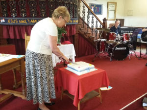 Jenny cutting the 200th Anniversary Cake
