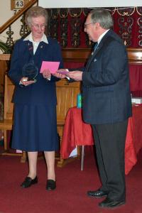 Howard presenting award to Beverley