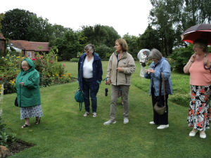 Being shown round garden