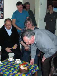 Howard blowing out candles