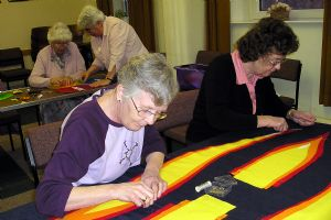 Joyce and Pauline working on a banner
