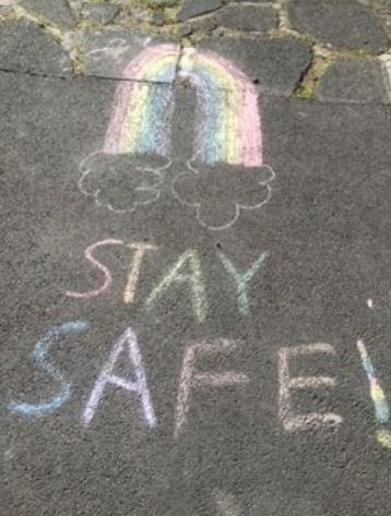 Rainbow & Stay Safe, chalked on pavement