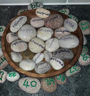 Emotions written onto pebbles