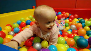 A picture of a toddler in our ball pool
