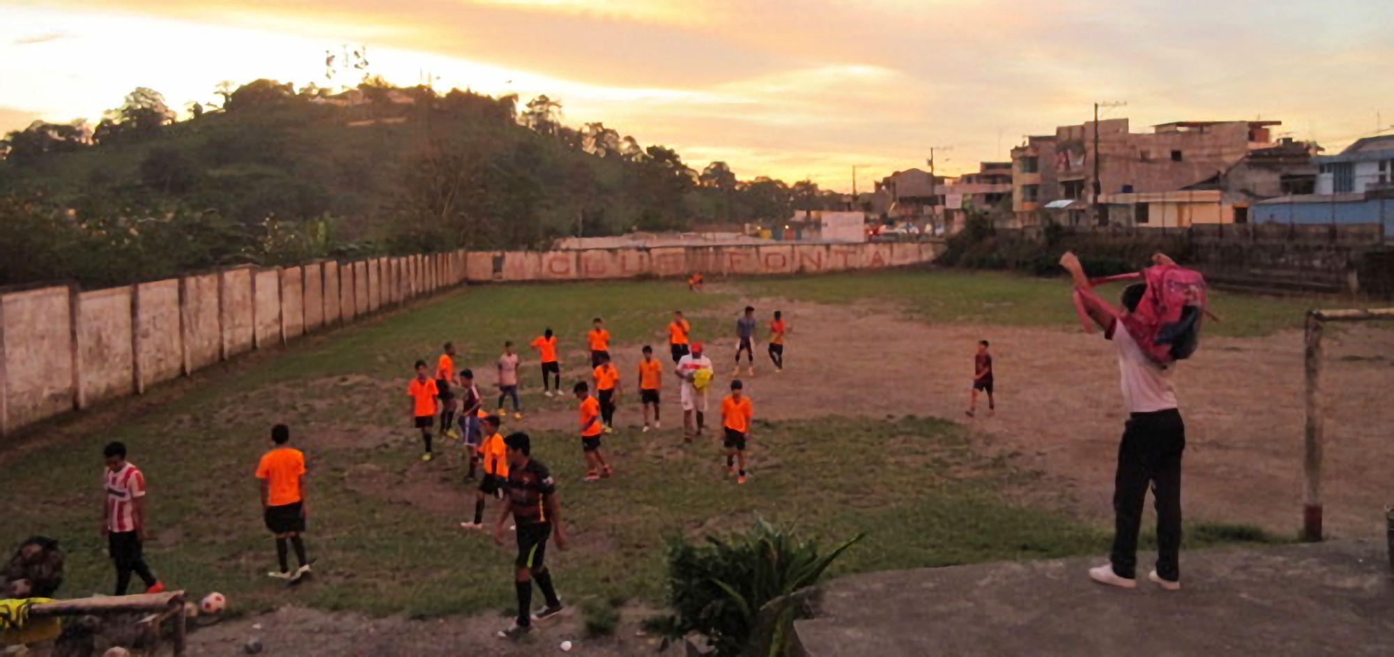 Boys football training at dusk