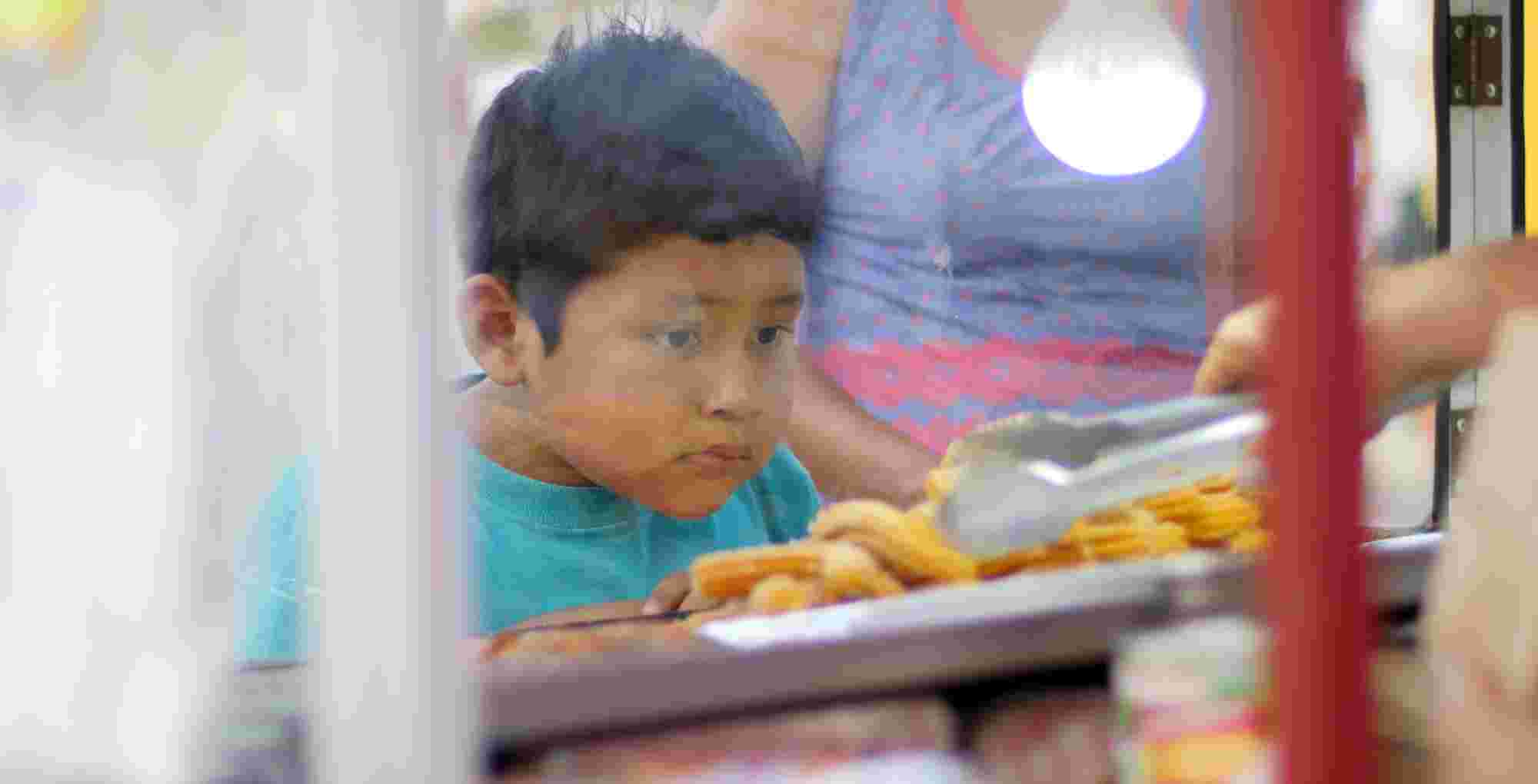 Boy waiting for Churros, CSW
