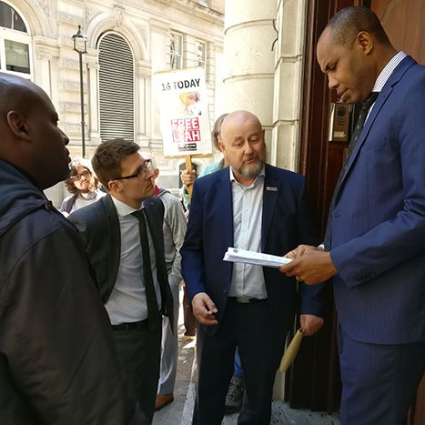 Petition being handed into the Nigerian High Commission in London