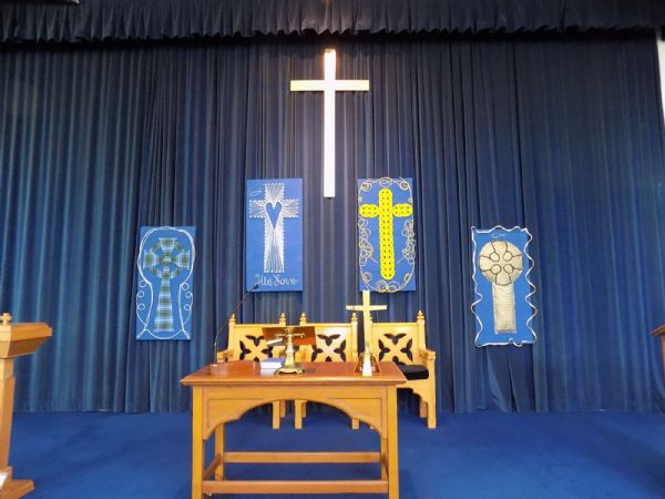 Image of communion table and crosses