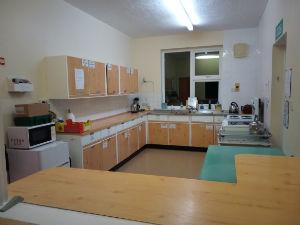 Kitchen viewed through the serving hatch.