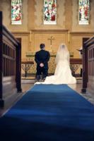 wedding couple at altar