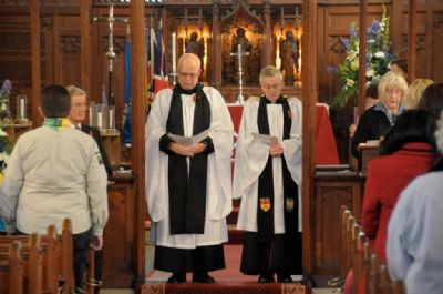 Vicar and Curate reading out the war dead