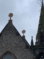Close up of replacement stone crosses on roof