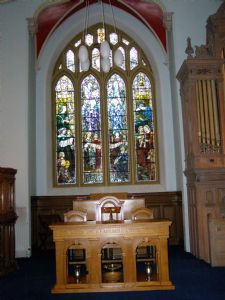Communion table and west window