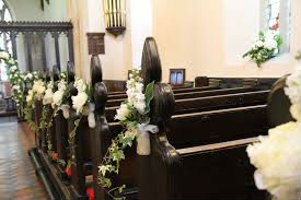 Pews trimmed with flowers for a wedding