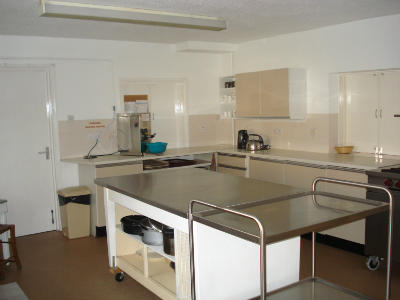 Kitchen with stainless steel work surfaces