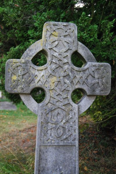 The top section of a tall cross surrounded by a circle in the form of a Celtic Cross